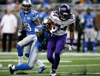 Dec 14, 2014; Detroit, MI, USA; Minnesota Vikings wide receiver Cordarrelle Patterson (84) gets tackled by Detroit Lions linebacker Julian Stanford (49) during the fourth quarter at Ford Field. Lions win 16-14. Mandatory Credit: Raj Mehta-USA TODAY Sports