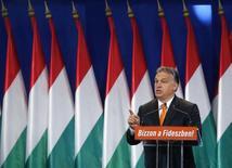 """Венгерский премьер-министр Виктор Орбан выступает с речью в Будапеште 19 октября 2014 года. Соединенные Штаты используют обвинения в коррупции в отношении венгерских чиновников как """"прикрытие"""" для усиления влияния в Центральной Европе в условиях российско-украинского конфликта, сказал во вторник премьер-министр Венгрии Виктор Орбан. REUTERS/Laszlo Balogh"""