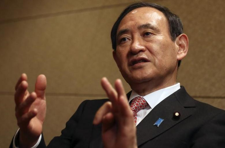 Japan's Chief Cabinet Secretary Yoshihide Suga speaks during an interview with Reuters in Tokyo February 15, 2014. REUTERS/Yuya Shino