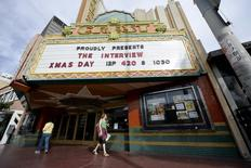 "The marquee of Crest Theater advertises the showing of the movie ""The Interview"" beginning Christmas Day in Los Angeles, California December 24, 2014.  REUTERS/Kevork Djansezian"