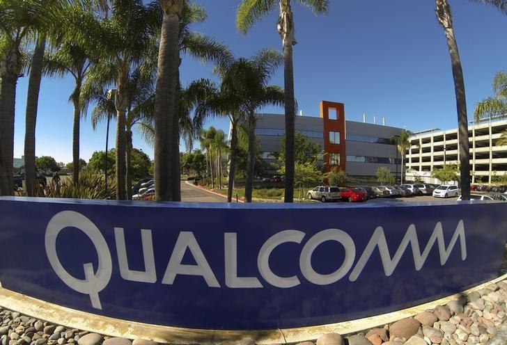 A Qualcomm sign is pictured in front of one of its many buildings in San Diego, California November 5, 2014.  REUTERS/Mike Blake