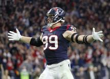Dec 28, 2014; Houston, TX, USA; Houston Texans defensive end J.J. Watt (99) reacts after making a sack for a safety during the second half against the Jacksonville Jaguars at NRG Stadium. Mandatory Credit: Kevin Jairaj-USA TODAY Sports