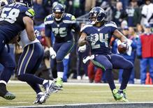 Dec 28, 2014; Seattle, WA, USA; Seattle Seahawks running back Marshawn Lynch (24) rushes for a touchdown against the St. Louis Rams during the fourth quarter at CenturyLink Field. Mandatory Credit: Joe Nicholson-USA TODAY Sports
