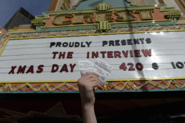 Tickets for the film ''The Interview'' is seen held up by theater manager Donald Melancon for the media at Crest Theater in Los Angeles, California December 24, 2014.  REUTERS/Kevork Djansezian