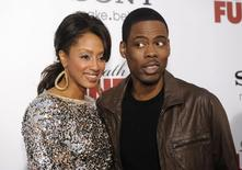 "Cast member Chris Rock (R) and wife Malaak Compton attend the premiere of the film ""Death at a Funeral"" in Los Angeles April 12, 2010. REUTERS/Phil McCarten"