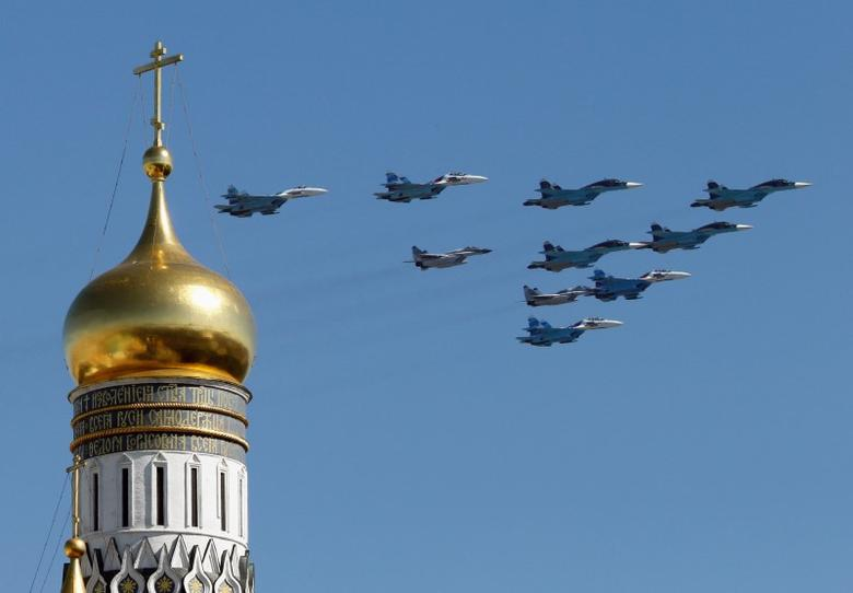 Russian military planes fly above the Kremlin, with the Ivan the Great Bell Tower seen in the foreground, during the Victory Day parade in Moscow's Red Square May 9, 2014. REUTERS/Tatyana Makeyeva