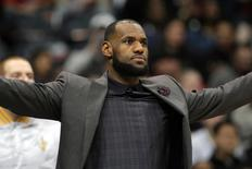 Cleveland Cavaliers forward LeBron James (23) reacts on the sidelines against the Atlanta Hawks in the second quarter at Philips Arena. Brett Davis-USA TODAY Sports