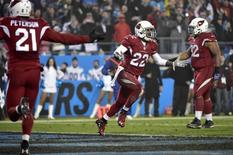 Jan 3, 2015; Charlotte, NC, USA; Arizona Cardinals strong safety Tony Jefferson (22) reacts after being called for pass interference during the third quarter against the Carolina Panthers in the 2014 NFC Wild Card playoff football game at Bank of America Stadium. Bob Donnan-USA TODAY Sports