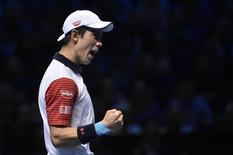 Kei Nishikori of Japan reacts during his semi-final tennis match against Novak Djokovic of Serbia at the ATP World Tour Finals at the O2 Arena in London November 15, 2014. REUTERS/Toby Melville
