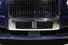A Rolls-Royce logo is seen on a car displayed on media day at the Paris Mondial de l'Automobile, October 3, 2014. REUTERS/Benoit Tessier