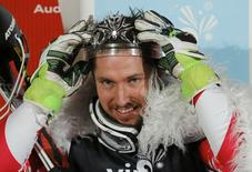 Marcel Hirscher of Austria poses with the winner's crown following the men's slalom at the Alpine Skiing World Cup in Zagreb January 6, 2015.               REUTERS/Antonio Bronic