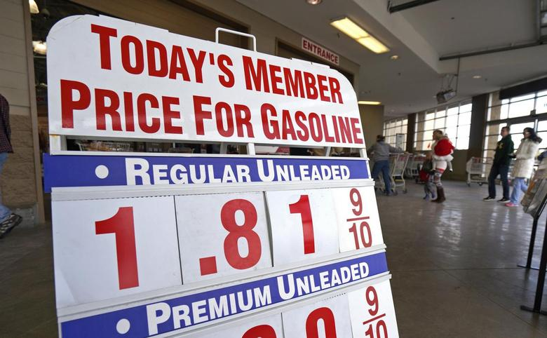 The price sign outside Costco in Westminster, Colorado, shows gas selling for $1.81.9 for the first time in years, December 23, 2014.  REUTERS/Rick Wilking
