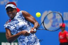 Venus Williams of the U.S. returns the ball during her women's singles match against Heather Watson of Britain at the China Open tennis tournament in Beijing September 28, 2014. REUTERS/Petar Kujundzic