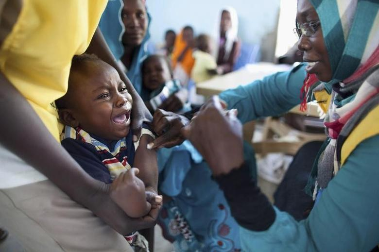 A child receives a meningitis vaccination at the community center in Al Neem camp for Internally Displaced People in El Daein, East Darfur October 8, 2012. REUTERS/United Nations-African Union Mission in Darfur/Albert Gonzalez Farran/Handout