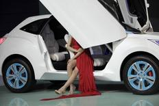 A model sits in a Haval E concept car from China's Great Wall Auto at Auto China 2012 in Beijing April 23, 2012.  REUTERS/Jason Lee