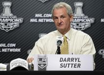 Los Angeles Kings head coach Darryl Sutter talks during a press conference after the Los Angeles Kings defeated the New York Rangers in second overtime during game five of the 2014 Stanley Cup Final at Staples Center. Mandatory Credit: Gary Vasquez-USA TODAY Sports
