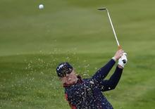 U.S. Ryder Cup player Hunter Mahan hits out of a bunker on the third hole during his foursomes 40th Ryder Cup match at Gleneagles in Scotland September 27, 2014.    REUTERS/Toby Melville
