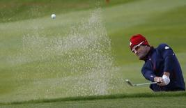 U.S. Ryder Cup player Zach Johnson hits out of a bunker on the ninth hole during practice ahead of the 2014 Ryder Cup at Gleneagles in Scotland September 25, 2014. REUTERS/Russell Cheyne