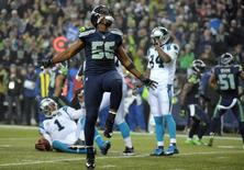January 10, 2015; Seattle, WA, USA; Seattle Seahawks defensive end Cliff Avril (56) celebrates after sacking Carolina Panthers quarterback Cam Newton (1) during the second half in the 2014 NFC Divisional playoff football game at CenturyLink Field.  Kirby Lee-USA TODAY Sports