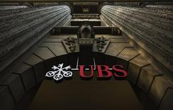 A file photo shows the logo of Swiss bank UBS on a building in Zurich December 19, 2012. REUTERS/Michael Buholzer/File