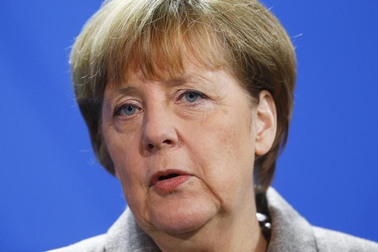 German Chancellor Angela Merkel speaks to media after her meeting with Turkish Prime Minister Ahmet Davutoglu at the Chancellery in Berlin, January 12, 2015.      REUTERS/Hannibal Hanschke