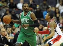 Jan 22, 2014; Washington, DC, USA; Boston Celtics small forward Jeff Green (8) dribbles as Washington Wizards shooting guard Bradley Beal (3) defends during the first half at Verizon Center. Mandatory Credit: Brad Mills-USA TODAY Sports