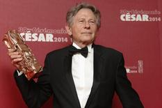 "Director Roman Polanski poses with his Best Director award for ""La Venus A La Fourrure"" (Venus in Fur) during a photocall at the 39th Cesar Awards ceremony in Paris February 28, 2014. REUTERS/Regis Duvignau"