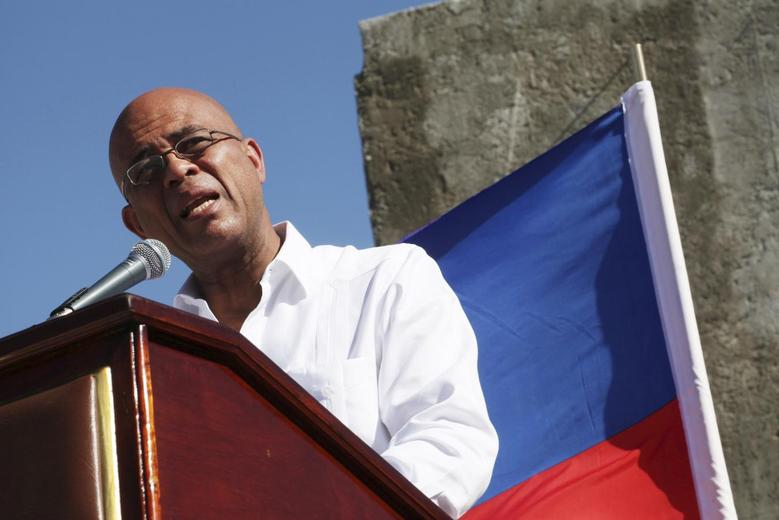 Haiti's President Michel Martelly addresses the audience during a memorial held for the victims of the 2010 earthquake in Titanyen, on the outskirts of Port-au-Prince January 12, 2015. REUTERS/Marie Arago