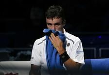 Spain's Roberto Bautista-Agut sits on the bench during his Kremlin Cup final tennis match against Croatia's Marin Cilic in Moscow October 19, 2014.  REUTERS/Grigory Dukor