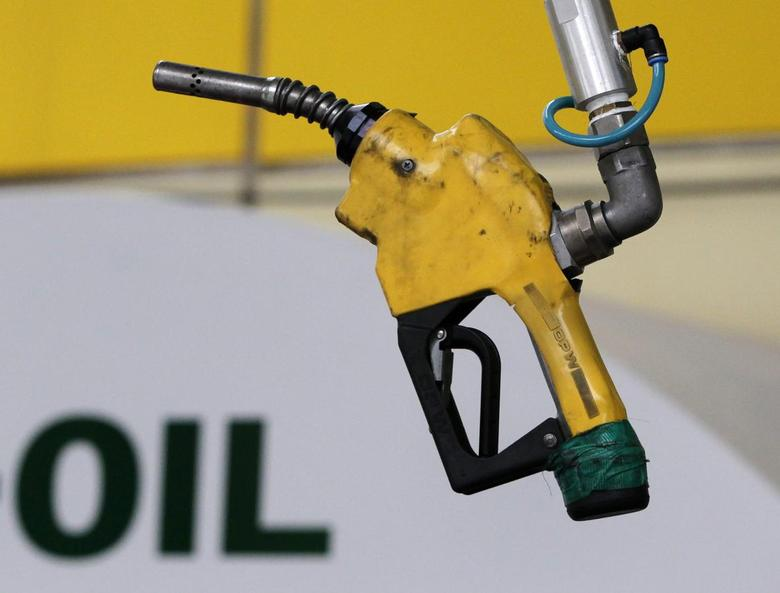 A gas pump is seen hanging from the ceiling at a petrol station in Seoul in this June 27, 2011 file photo.      REUTERS/Jo Yong-Hak