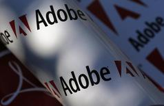 Adobe company logos are seen in this picture illustration taken in Vienna July 9, 2013. Picture taken July 9, 2013. REUTERS/Leonhard Foeger