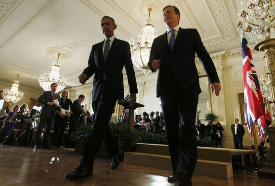 U.S. President Barack Obama (L) and British Prime Minister David Cameron (R) depart a joint news conference following their meeting at the White House in Washington January 16, 2015. REUTERS-Kevin Lamarque
