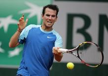 Adrian Mannarino of France hits a return to Guillermo Garcia-Lopez of Spain during their men's singles match at the French Open tennis tournament at the Roland Garros stadium in Paris May 29, 2014.      REUTERS/Stephane Mahe