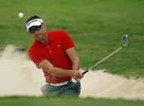 Robert Allenby of Australia hits out of the bunker on the 17th green during the third round of the Sony Open golf tournament at Waialae Country Club in Honolulu, Hawaii, January 11, 2014. REUTERS/Hugh Gentry