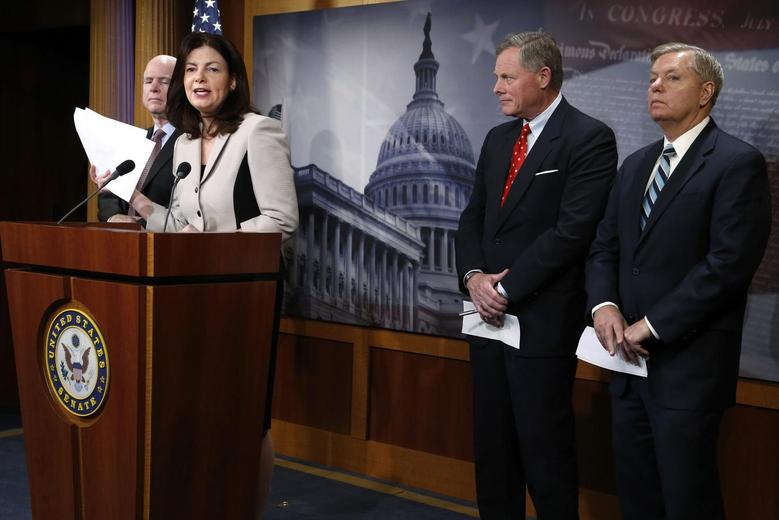 From L-R: U.S. Senator John McCain (R-AZ), Senator Kelly Ayotte (R-NH), Senator Richard Burr (R-NC) and Senator Lindsey Graham (R-SC) hold a news conference to talk about new legislation to restrict prisoner transfers from the detention center at Guantanamo Bay, at the U.S. Capitol in Washington January 13, 2015.  REUTERS/Jonathan Ernst