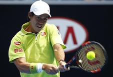 Kei Nishikori of Japan hits a return to Nicolas Almagro of Spain during their men's singles first round match at the Australian Open 2015 tennis tournament in Melbourne January 20, 2015.  REUTERS/Issei Kato