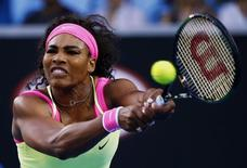 Serena Williams of the U.S. hits a return to Alison Van Uytvanck of Belgium during their women's singles first round match at the Australian Open 2015 tennis tournament in Melbourne January 20, 2015.  REUTERS/Issei Kato