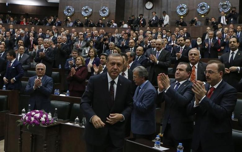 Turkey's Prime Minister Tayyip Erdogan leaves his seat to address members of parliament from his ruling AK Party (AKP) during a meeting at the Turkish parliament in Ankara April 8, 2014. REUTERS/Umit Bektas