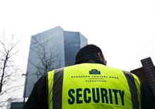 A security stands guard outside the new headquarters of the European Central Bank (ECB) in Frankfurt, January 22, 2015.  REUTERS/Kai Pfaffenbach