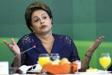 Brazilian President Dilma Rousseff speaks during breakfast with media at the Planalto Palace in Brasilia December 22, 2014. REUTERS/Joedson Alves