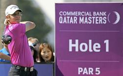 Emiliano Grillo of Argentina hits his tee-shot on the first hole during the third round of the Qatar Masters at Doha Golf Club in Doha, January 23, 2015. REUTERS/Fadi Al-Assaad