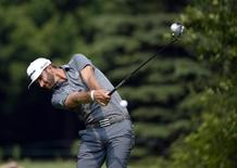 Jul 25, 2014; Ile Bizard, Quebec, CAN; Dustin Johnson tees off the 11th hole during the second round of the RBC Canadian Open at Royal Montreal GC - Blue Course.  Eric Bolte-USA TODAY Sports