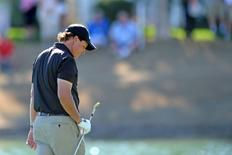 Jan 24, 2015; La Quinta, CA, USA; Phil Mickelson reacts to his second shot on the fourth hole in the third round of the Humana Challenge at PGA West - Arnold Palmer Private Course. Mandatory Credit: Jake Roth-USA TODAY Sports