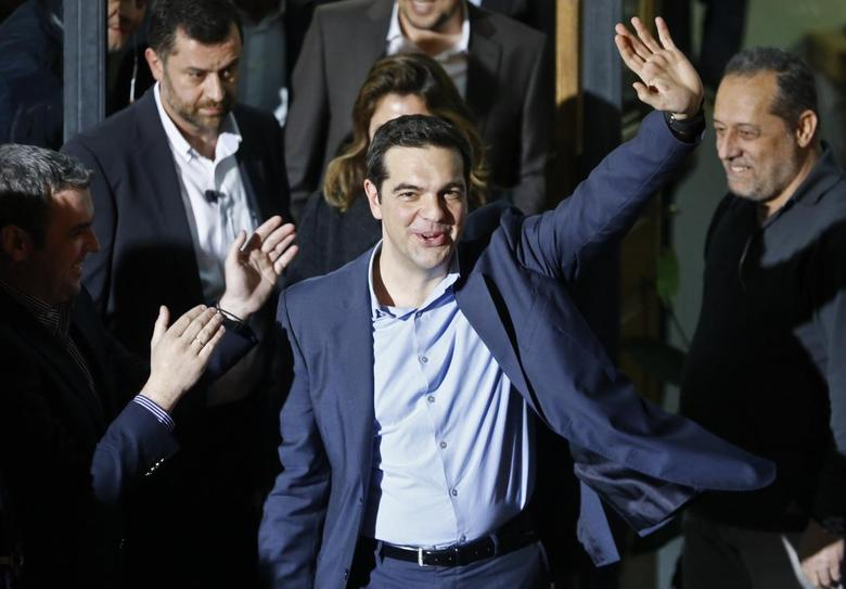 Head of radical leftist Syriza party Alexis Tsipras waves while leaving the party headquarters after winning the elections in Athens, January 25, 2015. REUTERS/Alkis Konstantinidis