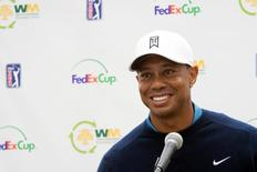 Jan 27, 2015; Scottsdale, AZ, USA; Tiger Woods reacts during his media press conference after a practice round at TPC Scottsdale Stadium Course. Mandatory Credit: Allan Henry-USA TODAY Sports