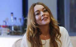 "Actress Lindsay Lohan rehearses a scene from ""Speed-the-Plow"" by David Mamet at the Playhouse Theatre in London September 30, 2014.  REUTERS/Suzanne Plunkett"