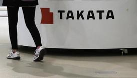 A visitor walks past displays of Takata Corp at a showroom for vehicles in Tokyo November 5, 2014. REUTERS/Toru Hanai