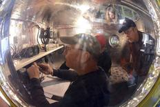 Bert Padelt (foreground) prepares the Two Eagles capsule for launch in Saga in this handout picture, received by Reuters on January 28, 2015, courtesy of Al Nels of the Two Eagles Balloon Team. REUTERS/Al Nels/Two Eagles Balloon Team/Handout via Reuters