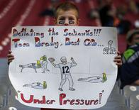 A young fan of New England Patriots quarterback Tom Brady holds up a sign before the start of the NFL Super Bowl XLIX football game against the Seattle Seahawks in Glendale, Arizona, February 1, 2015. REUTERS/Lucy Nicholson