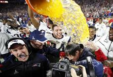 Feb 1, 2015; Glendale, AZ, USA;  New England Patriots head coach Bill Belichick is dunked with Gatorade after defeating the Seattle Seahawks in Super Bowl XLIX at University of Phoenix Stadium. Mandatory Credit: Mark J. Rebilas-USA TODAY Sports